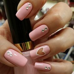 The negative space on this Valentine's Day nail art adds extra edge. Try it in black to make a serious statement!