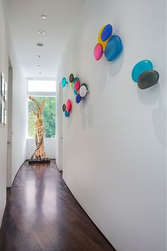 A Bright And Modern Entryway That Showcases Plenty Of Color And Artwork.  Vibrantly Patterned Area Rugs And Abstract Artwork Offer A Cheerful  Welcome, ...