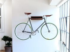10 ways to hang your bike on the wall like a work of art ~ ideas for your man cave someday.
