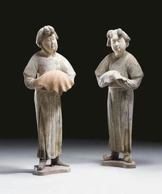 A pair of unusual painted grey pottery figures of female attendants, Tang dynasty (618-907)