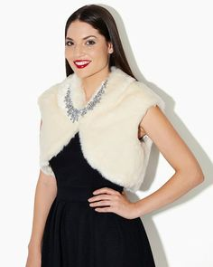 Shop winter fashion trends. Ivory or black faux fur cropped collared vest. Holiday essential is a fabulous alternative to a bulky jacket. Wear with form-fitting sweater and booties for celeb-inspired look.