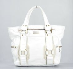 Authentic Jimmy Choo Morgan Tote Bag. This bag is done in white leather with gold hardware. The bag features a zippered fastened pocket on the front a zippered pocket on each side contrast panels and a zippered top.  - goalsBox™