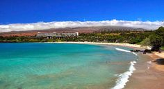 Kauna'oa Beach (Mauna Kea Beach) is one of the prettiest white sand beaches on the Big Island of Hawaii. A family beach good for sunbathing and snorkeling