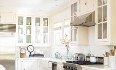 Provides examples of Whites to use based on house style - Lighten your kitchen's look for less with white cabinets. Learn how to find the perfect shade with these pro paint tips.