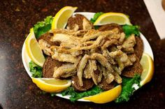 "Russian Fried Smelt (Koryushka) -This easy recipe for Russian Pan-Fried Smelts is a common way to prepare this tiny fish, no matter what country you happen to be in. It often appears on ""zakuski"" (appetizer) spreads at home and in pubs and cafes. ( © Barbara Rolek)"