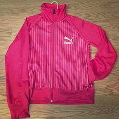 Hot pink Puma track jacket Such a cute jacket! Size XL but fits like a L, RE-posh. Does have small paint mark on inner sleeve, shown. Otherwise excellent condition! Smoke free home. Offers welcome Puma Jackets & Coats