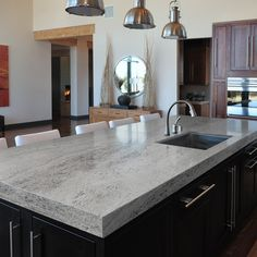 Sensa Silver Silk Granite with dark cabinets $64/square foot at lowes
