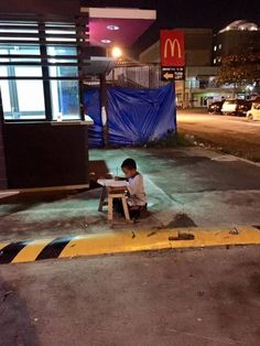 does his homework outside the McDonalds drive-through where lighting is adequate