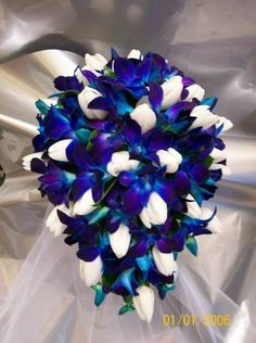 Something like this for my bouquet. The other one I have on here will be for my bridesmaids...and the spare one to toss to the single ladies :) I wanna preserve my personal one