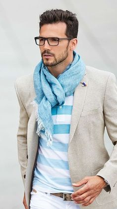 We love when a man pairs a scarf with a well fitted, casual outfit like this one. Scarves are not limited to florals anymore, and this certainly isn't your grandmother's shawl!