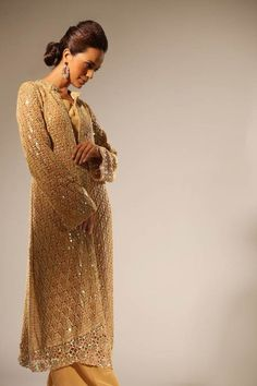 Classic gold jacket with zardozi panelling and neckline by Delphi, available at O'nitaa.  #OnitaaLondon