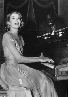 "Grace plays piano, pictured on set filming ""High Society."" Elegantly of course!"