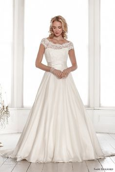 Lace boat neck gown with cap sleeve and soft organza skirt