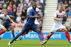 Powering in: Bailly in action in United's 2-0 win at Wigan