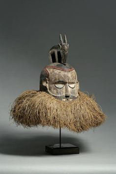 """A fine and rare Yaka/Suku helmet mask Democratic Republic of Congo, a large bell-shaped helmet mask, with heavily lidded eyes and white pigmented face. Carved figure of an antelope on top of the mask; large fiber ruff around the perimeter. height 20in FOOTNOTES Dr. Arthur P. Bourgeois has added the following: """"This Suku-style mask derives from the Yaka of Matsese village, Mwanga locale, Kasongo Lunda Zone and Zalala Makala, Mwela Lembwa locale, to the east of the Wamba River. This variety of…"""