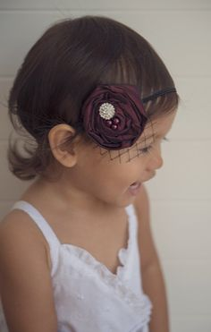 This listing is for an adorable burgundy rosette headband with black bird cage netting. This vintage inspired headband has a hand made