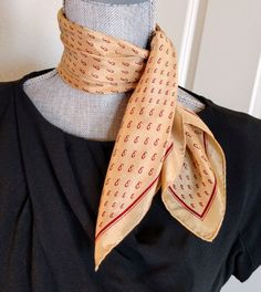 Vintage scarf by The Specialty House, Japan, ca. 1980s. 20 1/2 square, 100% silk.  Lustrous camel colored silk with burgundy trim and E initial repeating pattern.  Lightweight, smooth, and beautiful.   Excellent vintage condition. No rips, snags, stains, discoloration, or odor. Washed and pressed by hand. Please zoom in on photos above for details.  Clean, soft, and ready to wear.   Bought originally in Maine and owned by the same family for 35 years.   Shop with confidence! I will combi...