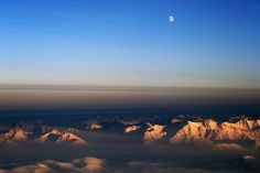 The moon just over the horizon seen from the NASA P-3 over northeast Greenland during an IceBridge survey flight on Mar. 12, 2014.   Credit: NASA / Michael Studinger   NASA's Operation IceBridge is an airborne science mission to study Earth's polar ice. For more information about IceBridge, visit: www.nasa.gov/icebridge