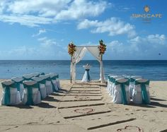 Walk down an aisle of hearts in the sand in this romantic and fun destination wedding ceremony at Sunscape Sabor Cozumel.