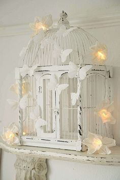 What a beautiful cage...white butterflies and white fairy lights... perfect for bridal or baby shower!
