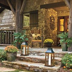 Stepping-Stone Entry | Randomly placed stepping-stones crafted from local granite lead to the front porch's wide steps. | SouthernLiving.com
