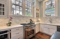 Transitional Kitchen with Marble Stone Backsplash