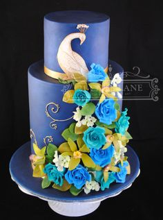 This Cake was made in a class at Planet Cake in Balmain, Sydney It's 3×9″ mud cakes and 1.5×6″ mud cakes. The Blue was achieved using blue fondant, which was then airbrushed with a Navy I made mixing blue, with Navy, Black and alcohol.