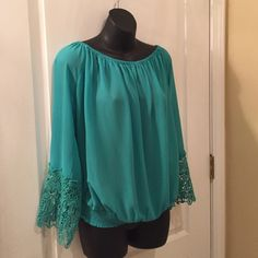 Umgee Top Off the shoulder in pretty Tiffany blue/green color...elastic neck & waistline...V-shaped slit in back...NWT! Umgee Tops