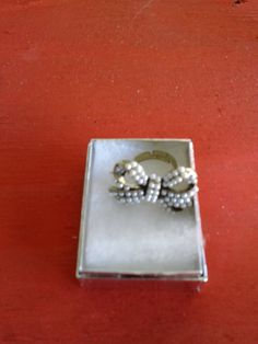 Large Pearl Bow Ring. $8.00, via Etsy.... this would match a necklace I got from Plato's Closet!