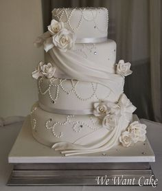 Classic Wedding Cake... Kinda love it in a weird way, but not too sure about the pearls; probably would do a flower here and there maybe
