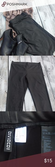 Divided H&M brand leather look leggings These leggings are STUNNING!  They are perfect when paired with a silk top and some heels for a night on the town.  They are in like new condition. Divided Pants Leggings