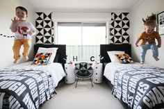 Modern Black and White Shared Boys Room - the geometric accent walls add a great pop of pattern!