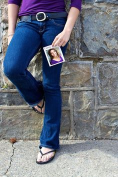 Senior Portraits senior-portraits maybe? Could be she holds a pic of her much younger