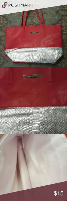 Vince Camuto Raspberry Carry All Tote Bag Vince Camuto Raspberry Sorbet Colored Carry All Tote Bag. The perfect bag to just throw everything in and go! Nice big size but not too big. Perfect for a day out. Excellent condition used twice. Faux leather with a silver faux snake accent across bottom of bag glams it up a little bit. The 4th pic is showing the truest color. Pink nylon lining inside excellent condition. Vince Camuto Bags Totes