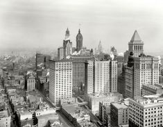 """New York circa 1912. """"Big buildings of Lower Manhattan."""" Landmarks here include the Singer Building and, under construction, the Woolworth tower. And let's not overlook the Hotel Grütli."""