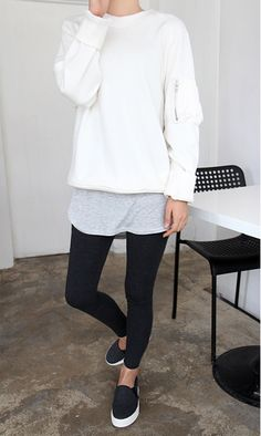 White sweater;; long gray shirt underneath;; black leggings;; black and white shoes