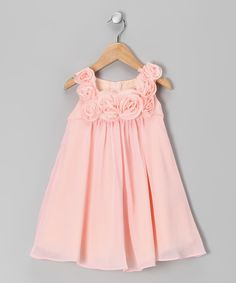 A soft neckline of rosettes makes this dainty dress a standout hit. With an easy-on back zipper, luxurious overlay and soft lining, this fabulous frock pretties up any little princess.100% polyesterMachine wash; tumble dryMade in the USA