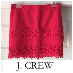 J. Crew red mini skirt with lace detailing Worn once! Red J. Crew mini skirt. Size 0. In perfect condition. Skirt comes to mid thigh area and has hidden zipper in the back. Also has a red lining layer. Detailing is beautiful red lace panels. Skirt is 100% cotton and the liner is 96% cotton 4% spandex. J. Crew Skirts Mini