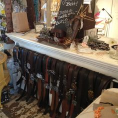 Fall rhinestone belt buckle and leather belt store display at Beekeeper's Cottage