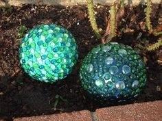 Old light fixtures ... Bowling balls covered with glass pebbles. Cool!