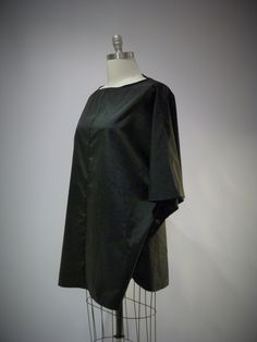 [re-fashioned raincoat-to-tunic project, creating a rain top concept as a new stylish concept to rainwear]
