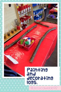 Painting and decorating giant logs! EYFS