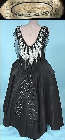 Late 1940s HATTIE CARNEGIE Black Silk Taffeta Gown Covered with Deco Design Rhinestones.  Hattie Carnegie was never actually a fashion designer, but rather her shops imported expensive original designer Parisian models, as well as employing renowned house designers. The couturiers whose models she imported included Lanvin, Vionnet, Molyneux, Mainbocher Chanel, Patou, Schiaparelli, and Charles James.