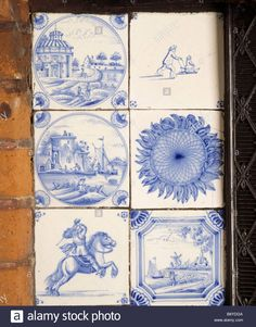 Delftware blue and white tiles in the fireplace in the Dining Room at Red House. The fireplace has a large brick surround and the room was used by Morris as a living room.