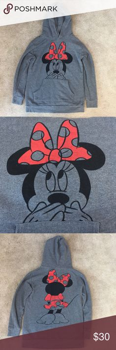 Minnie Mouse Disney sweatshirt Minnie Mouse Disney sweatshirt with hood and pocket in front. 2 small stains noted in pictures. My sisters initials are on the back of the tag but obviously can't be seen when worn! Disney Tops Sweatshirts & Hoodies