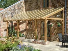 This glazed roof pergola blends in perfectly with the barn conversion.