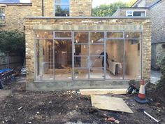 stunning steel Crittal style doors, bronze inside, silver outside, going in ilast week n a VCDesign Extension Project in Roehampton Glass Extension, Roof Extension, Porch Windows, Windows And Doors, Crittal Doors, Crittall Windows, Sutton House, Kitchen Diner Extension, Bungalow Renovation