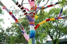 love this for a window display...tree limbs covered in yarn!