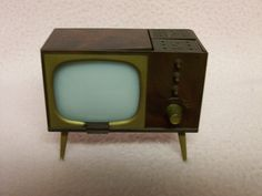Salt and PEPPER TELEVISION Console Salt and Pepper Shakers Plastic 1950s Retro Style. $16.50, via Etsy.