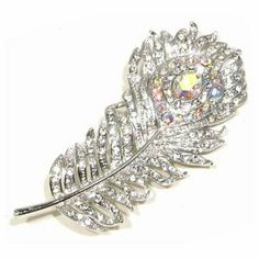 Clear and AB Color Austrian Crystal Rhinestone Peacock Feather Designed Silver-Tone Brooch Pin with Rhodium Plated Fashion Jewelry. $19.95. Size: 2.75 inch by 1.25 inch. Material: Austrian Crystal Rhinestone. Metal: Silver-Tone with Rhodium Plated